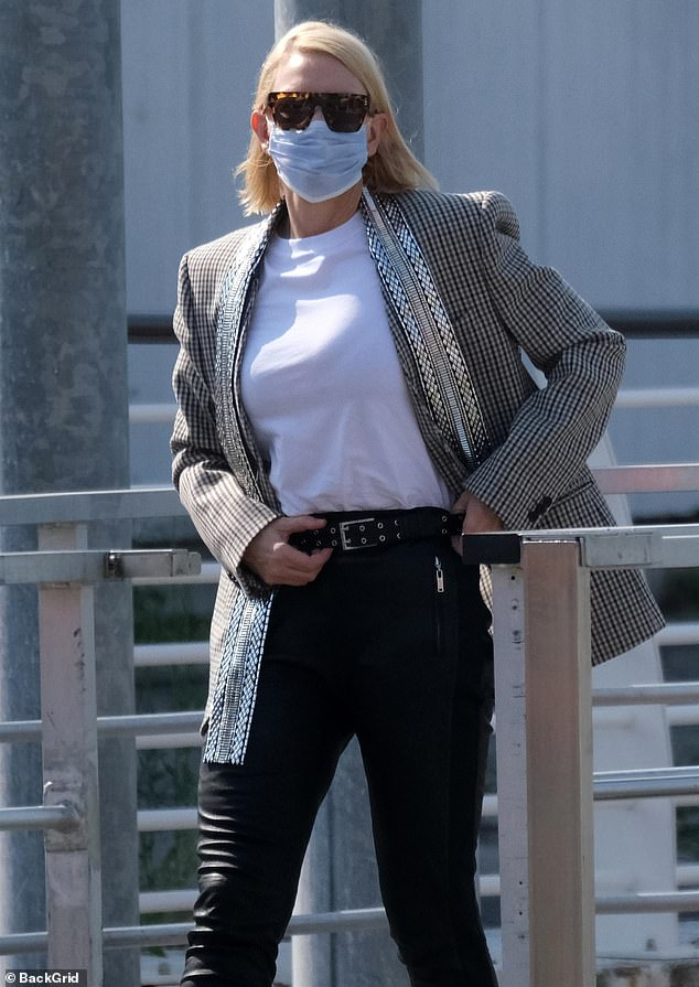 Looking good:The Australian actress, 51, caught the eye in a check blazer and skinny leather trousers as she left her hotel following the festival's closing ceremony the previous evening