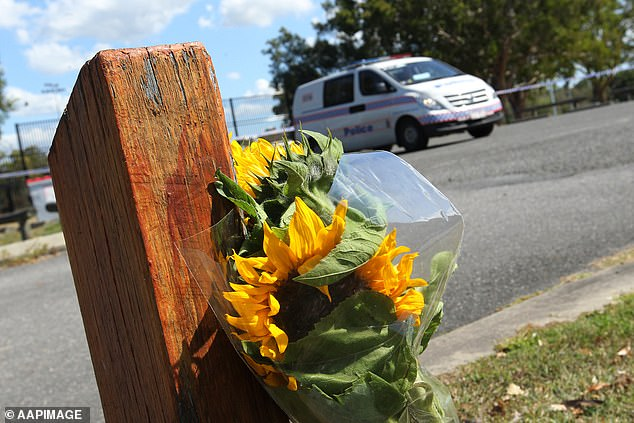 A lone bunch of flowers were left at the crime scene on Monday afternoon