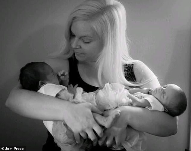 Lindsey pictured with Maci and Mackenzi shortly after their birth. Lindsey said the addition to her family gave her a newfound sense of purpose