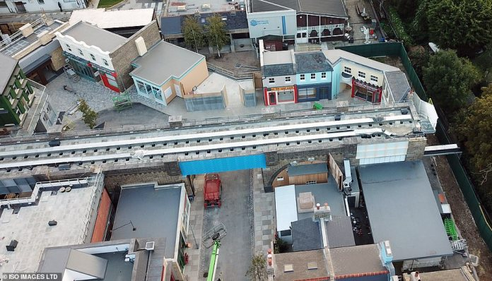Authentic: The railway line sits high above the square and its network of currently empty streets