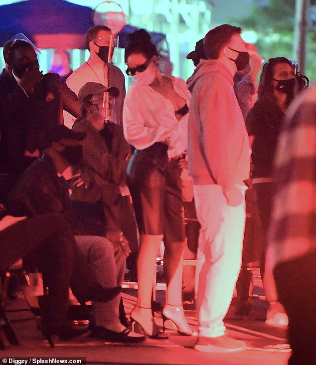 Sexy: Rihanna continued to flash her bra as she put on her satorial display