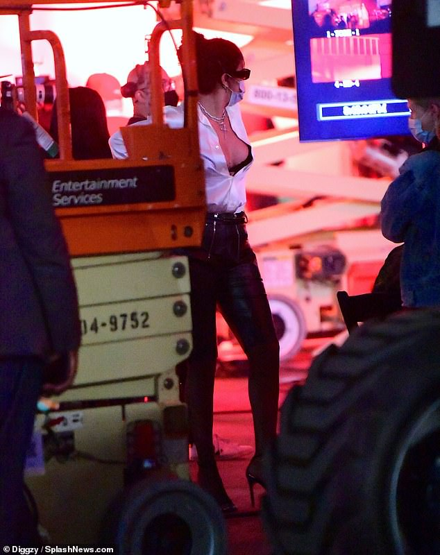 Businesswoman: The singer turned designer appeared to be directing the mystery shoot and watched on closely in front of a large display screen