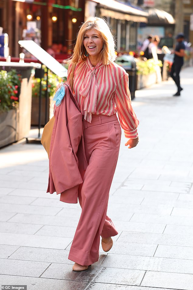 Triumphant return: Kate Garraway looked cheery in a pink suit as she headed back to work at Smooth Radio for the first time since her husband Derek's coronavirus battle on Monday