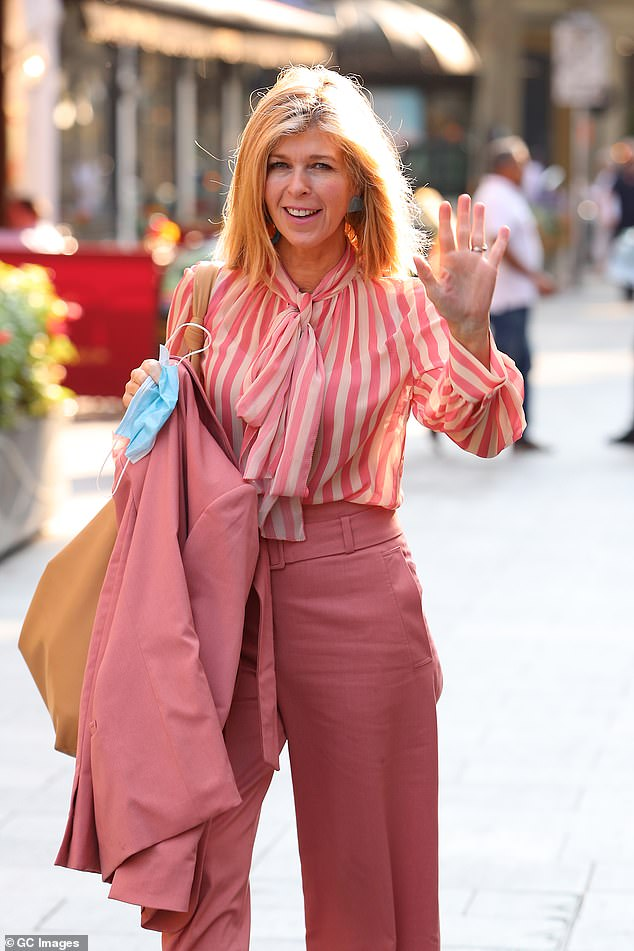 Glowing: The presenter, 53, looked like a ray of sunshine in a pink suit as she strutted into Global Studios