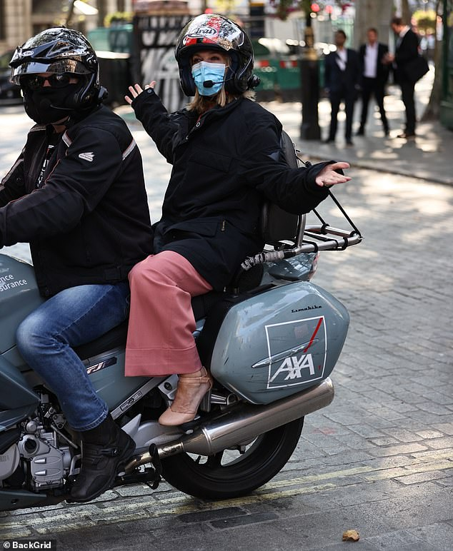 Quite the arrival! Kate rocked up to the studios on a snazzy motorbike, donning a safety helmet and mask