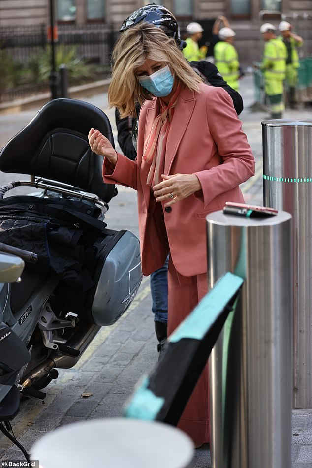 Here I am: The blonde beauty made sure to put safety first as she donned a face mask during her arrival