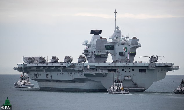 The Royal Navy aircraft carrier HMS Queen Elizabeth leaves Portsmouth Naval Base last week. The navy has less warships than the MoD has diversity and quality officers