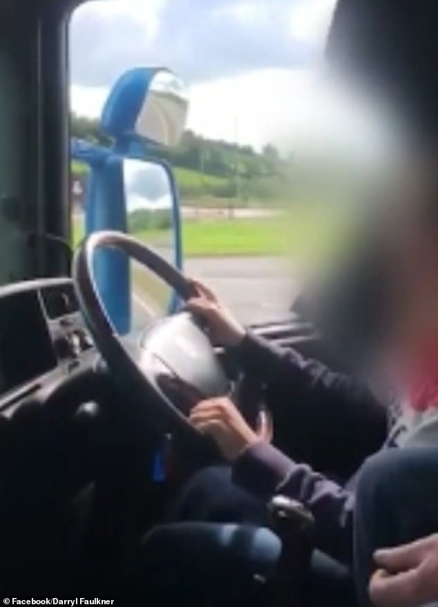 The young girl was filmed steering the huge truck along the M1 near Dungannon, Northern Ireland