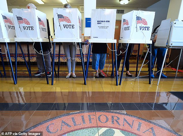People vote on the US presidential election at Santa Monica City Hall on November 8, 2016 in Santa Monica, California