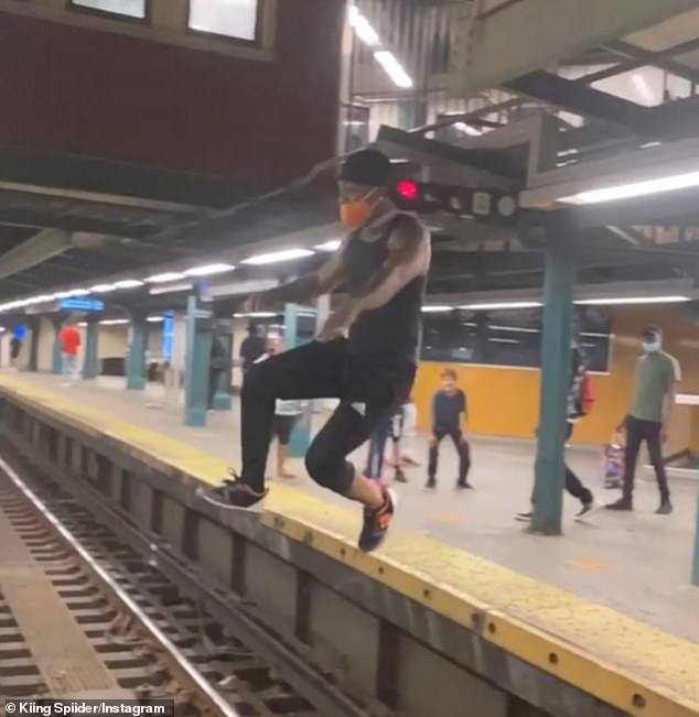 This is the moment a fearless subway rider leaped from one platform to another - and nailed the landing