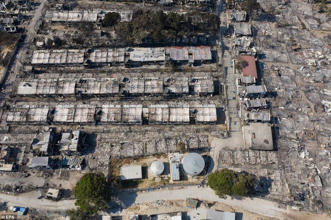 An image taken with a drone shows an aerial view of the burnt-down Moria refugee camp on Lesbos island, Greece, on September 14