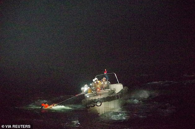 A Filipino crew member (pictured) who was rescued after a distress signal was sent by the Australian owned Gulf Livestock 1 said the ship capsized and sunk in rough weather