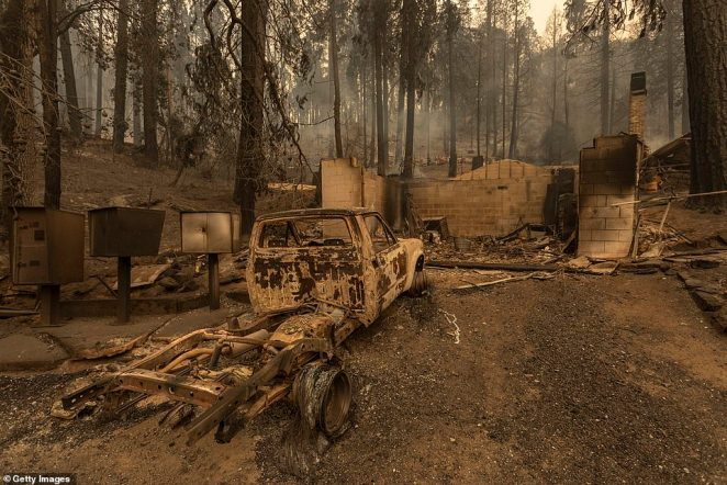 Burnt out homes and cars are pictured in the Meadow Lakes area of California after the Creek Fire swept through