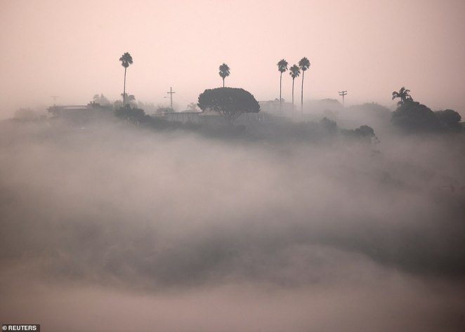 Thick fog and smoke covers Solana Beach, California, on Monday amid record-breaking wildfires