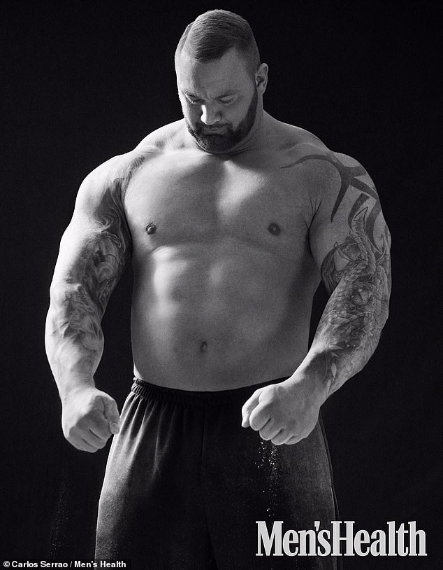 Strongman: Hafthor Björnsson, 31, showed off his hulking physique as he posed for Men's Health magazine and discussed breaking the world deadlift record
