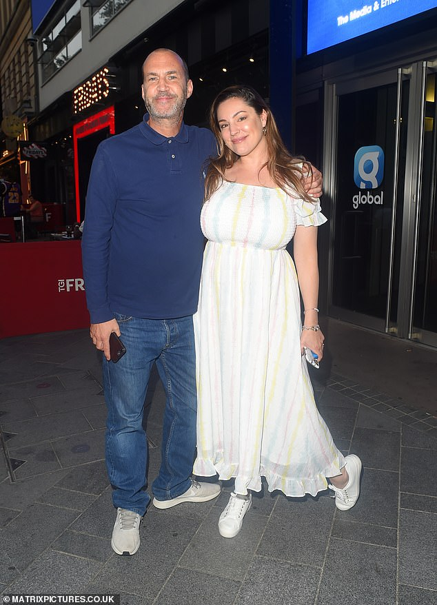 Pals:The beauty, 40, looked stylish in a pastel summer dress as she embraced Johnny, 54, in the street