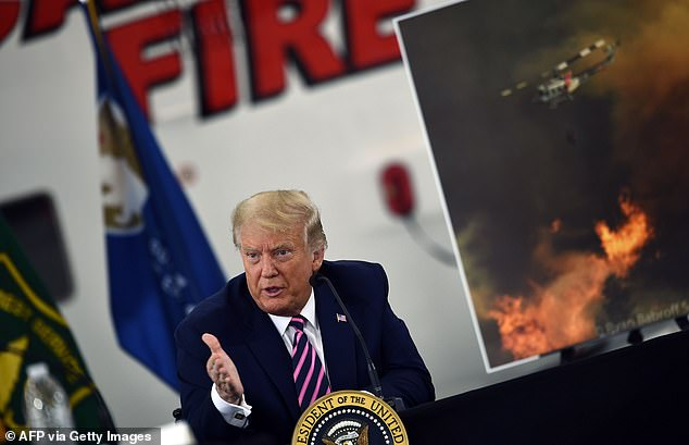 President Donald Trump speaks during a briefing on wildfires with local and federal fire and emergency officials at Sacramento McClellan Airport in McClellan Park, California on September 14, 2020. Trump said this weekend he would 'negotiate' for a third term if he wins reelection