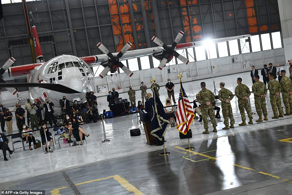 Medals: Families of the members of the California National Guard were present for them to receive the Distinguished Flying Crosses