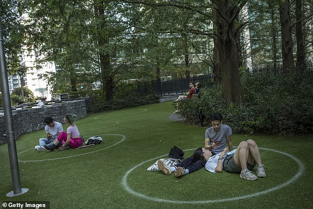 With the Government's so-called Rule of Six (above, people use social distancing markers in a Canary Wharf park), there are fears people will still be reluctant to visit surgeries and A&E