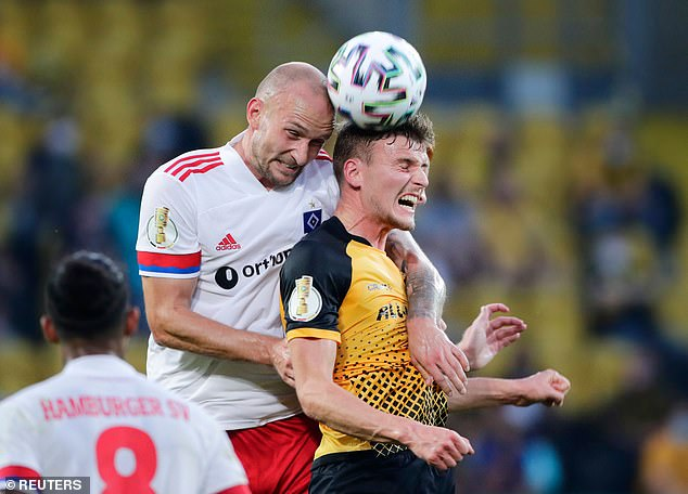 Hamburg defender Toni Leistner (L) was involved in altercation with Dynamo Dresden fan