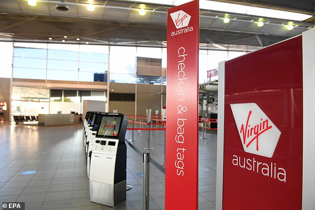 A Virgin Australia spokeswoman confirmed Mr Scurrah had told staff state border closures were hurting the finances of the airline. Pictured are empty check-in terminals at Sydney domestic airport