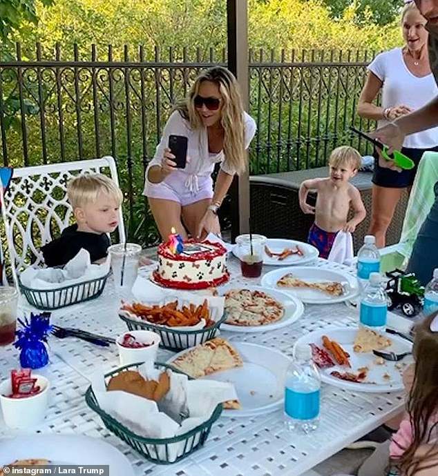 Proud mom: Lara had her phone out and ready to right before Luke blew out the candle