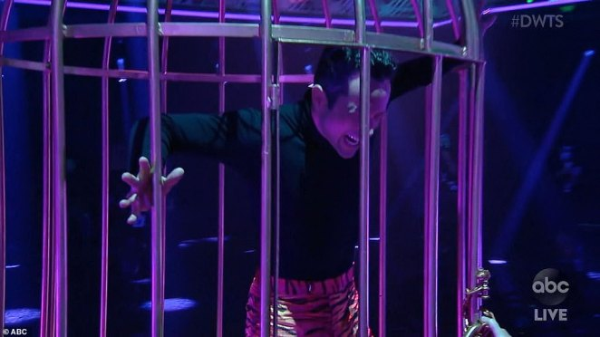 In cage: Their paso doble routine opened with Pashkov trapped in a cage