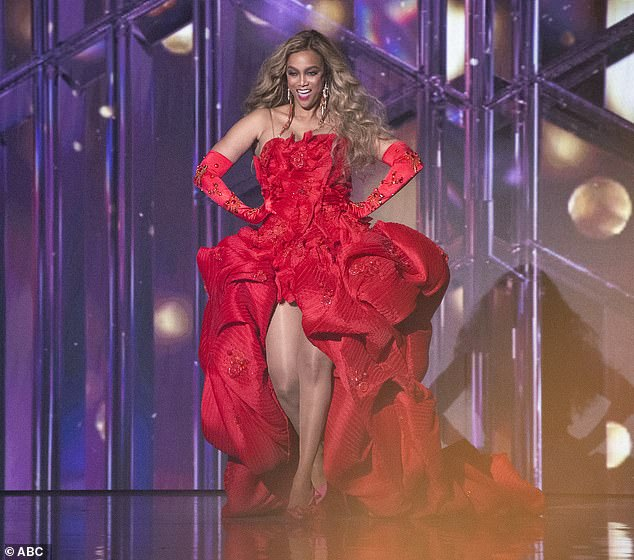 Stunning: The 46-year-old supermodel, who replaced show veterans Tom Bergeron and Erin Andrews, donned a stunning bright red ball gown and matching arm-length gloves