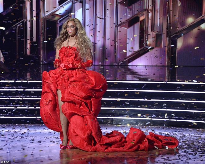 Runway ready: The model and America's Next Top Model creator looked runway ready in a long red dress with a train