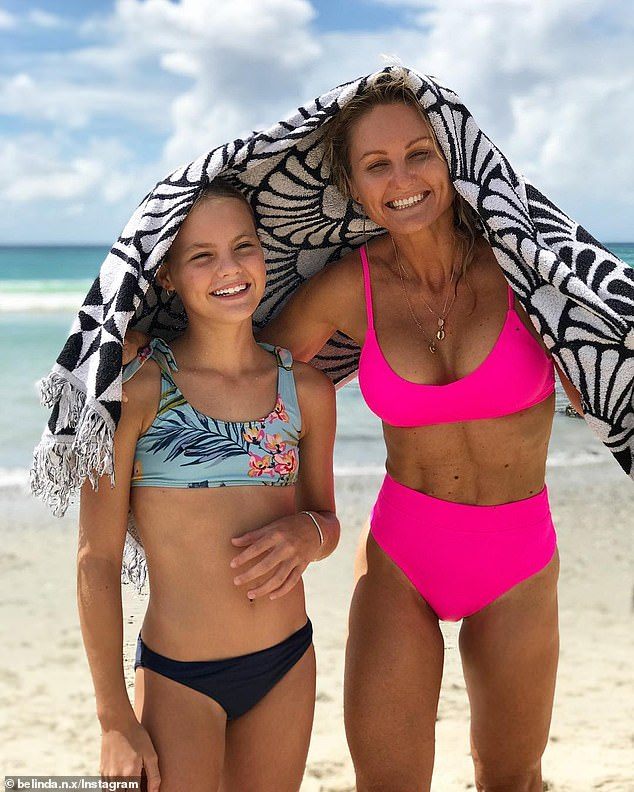 'Our health and wellness is determined by how our body functions not how big our muscles are, not how thick our glutes are and certainly not by our abdominals,' she said (pictured with her daughter)