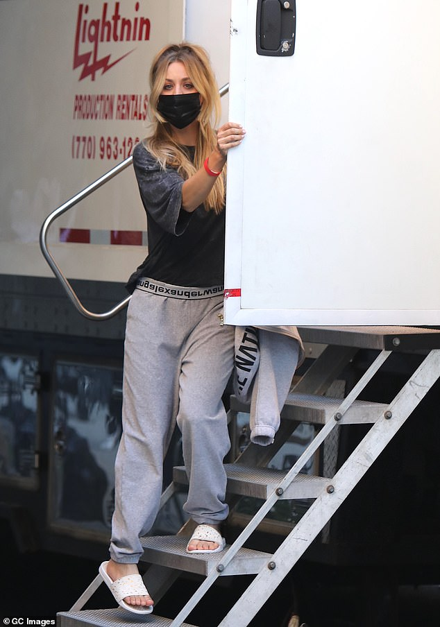Trailer: The screen star emerged from her trailer in grey tracksuit bottoms with a dark top