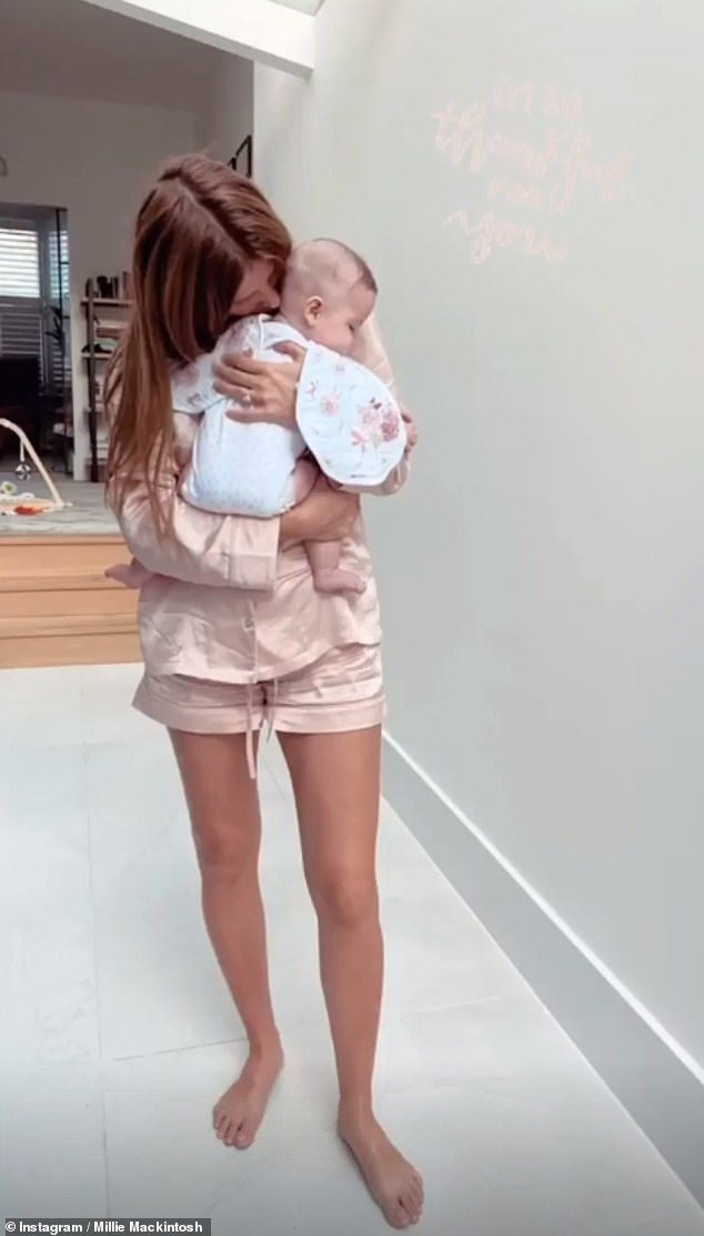 Doting mother: The former Made In Chelsea star, 31, took to her Instagram Stories on Monday to share two sweets snaps of herself cuddling the youngster