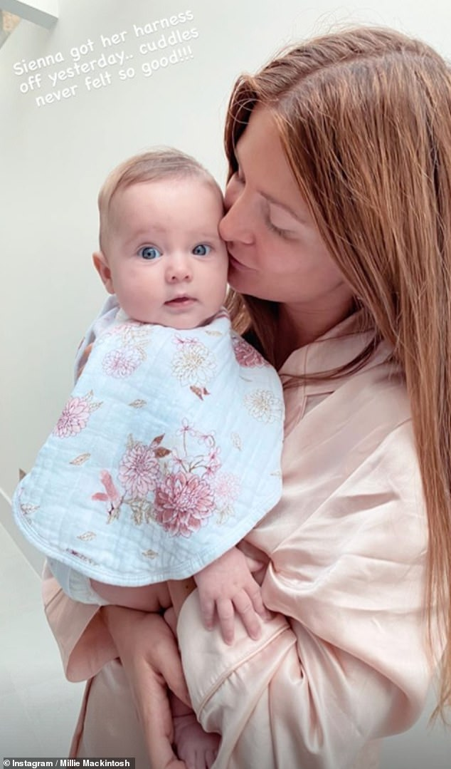 Sweet: Millie Mackintosh has revealed that her baby daughter Sienna, four months, has had her harness removed after she was diagnosed with hip dysplasia in August