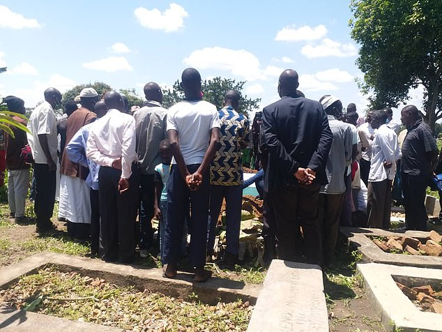 Mercy's family and friends gather around her grave as her body is lowered in