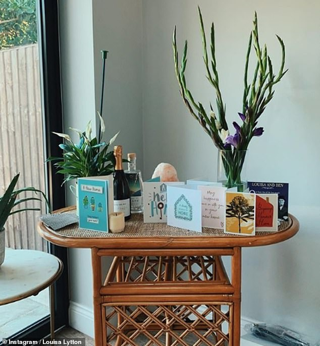 Pretty corner:The following evening the star shared another snap of the cards she'd received to congratulate her on the move, perched neatly on a new rattan table