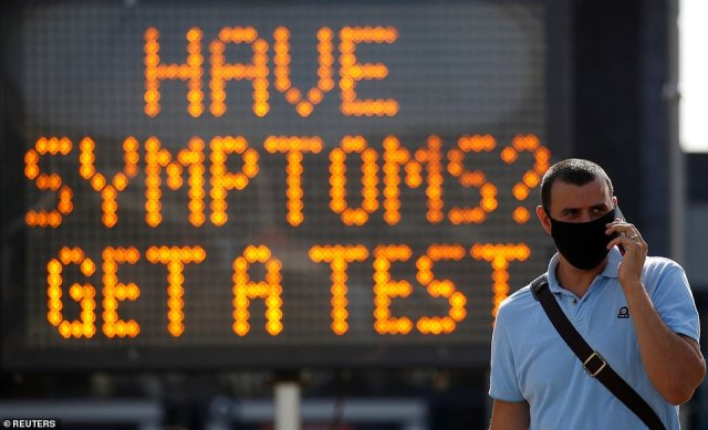 A sign in Bolton orders those suffering coronavirus symptoms to get a test, despite a lack of testing capacity