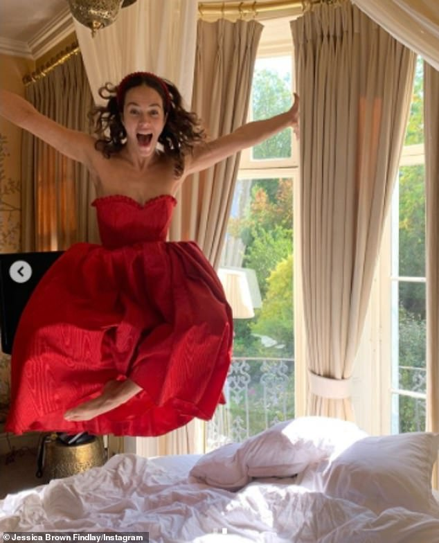 Bride! In another photo, the actress wore a gorgeous red strapless and ruffled gown as she jumped on a bed in excitement