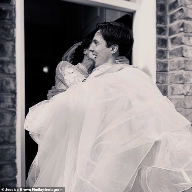 Happiness:While Ziggy carried Jessica over the threshold into their home in a different sweet black-and-white photo