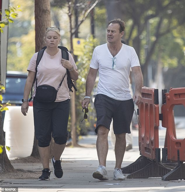 Low-key look: Keeping things casual for the outing, the Australian actor opted for a plain white T-shirt and navy shorts