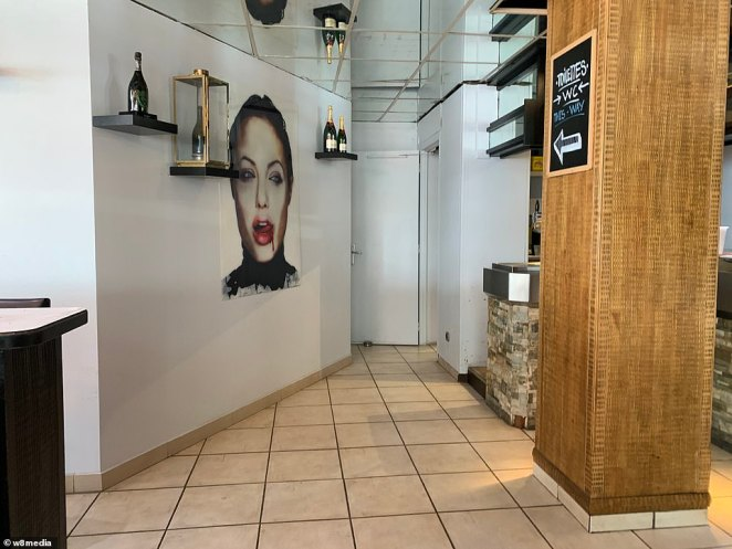 A giant mural of a face of woman licking her lips as blood trickles down her chin is at the entrance of the toilets, believed to be where McGregor allegedly exposed his manhood to a young married French woman in September 6