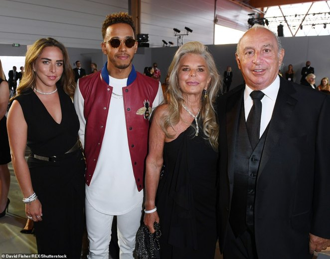 The whole clan: Lewis has frequently spent time with Philip and the Green family, with the friendship seemingly blossoming at the 2015 Met Gala, where Lewis wore a Topshop suit (Lewis with Chloe, Tina and Philip Green in 2017)