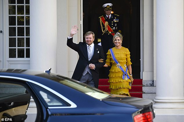 The pair smiled and waved as they left arm in arm from the Noordeinde Palace before getting into the car to drive to the Grote Kerk for the King's speech