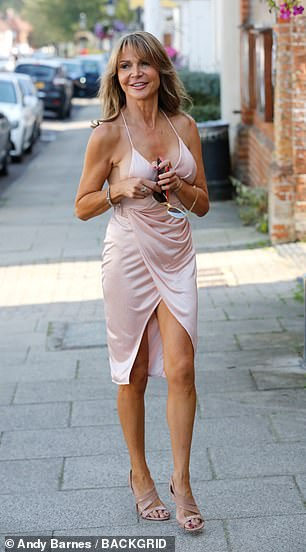 Working it: Lizzie Cundy headed out in style as she left her country house in Hampshire for a date on Tuesday afternoon