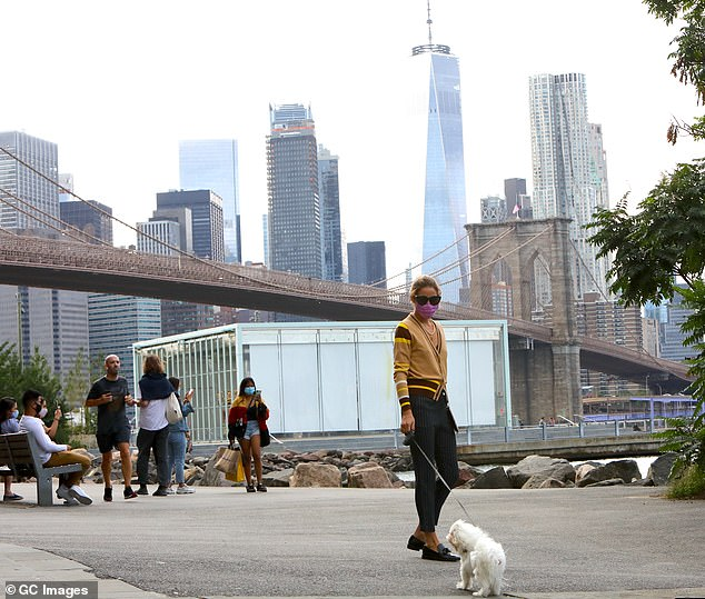 Views for days: She pounded the pavement in black leather loafers while her Maltese pup, Mr. Butler, walked beside her