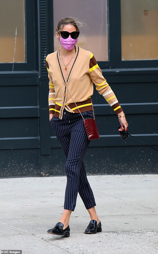 City slicker: Olivia Palermo mixed bold colors and prints as she stepped out for a walk in New York on Tuesday morning