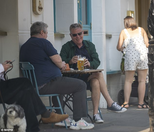Beers: The pals enjoyed a few beers as the English capital enjoyed unseasonably warm weather