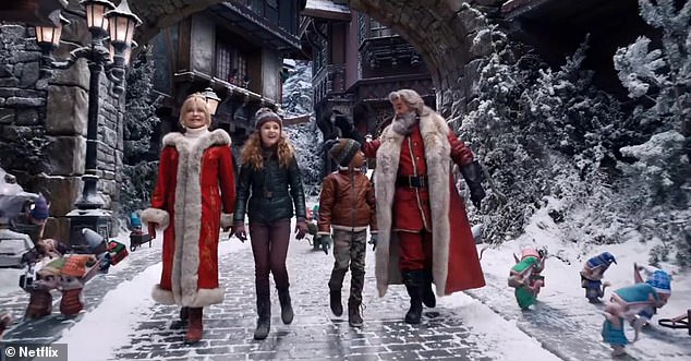 Elves lining the streets: In the preview, 'true believer' teenager Kate Pierce (Darby Camp) and her pal Jack (Jahzir Bruno) get a personalized tour of Santa's Village by the Claus couple