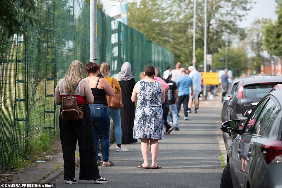 A long queue outside a testing site in Gorton, Manchester