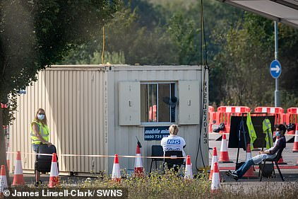 Cambridge residents have complained that a testing site there is unused (Pictured: Staff do not have any visitors to work with) but local people can't get tested there