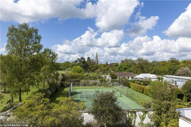 As well as a vineyard on your doorstep, the home is surrounded by beautifully manicured lawns, a lake where the old mansion once stood, and an impressive walled garden with a tennis court (pictured)